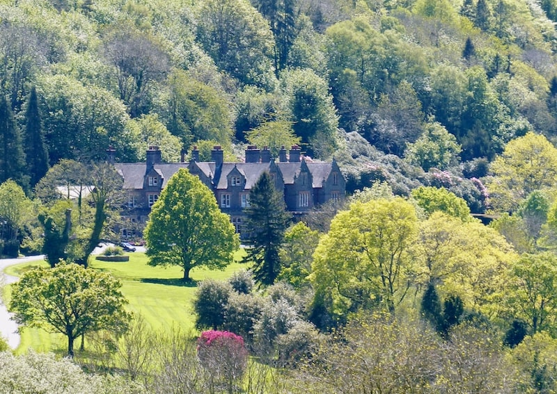 Buckland Hall retreat venue in Wales surrounded by trees and hills